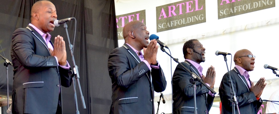 Sing Baby Sing live on stage at Summer Soulstice 2015. Photo by Paul Welch © Summer Soulstice Ltd.