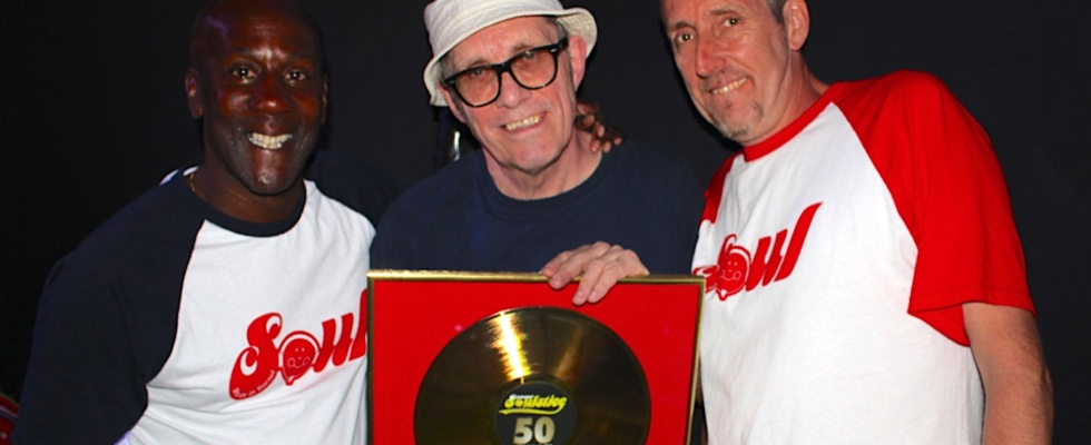 Richard Weekes & Jamie Topham present Dr Bob Jones with a special gold disc to mark his 50 years behind the decks at Summer Soulstice 2017. © Summer Soulstice Ltd.